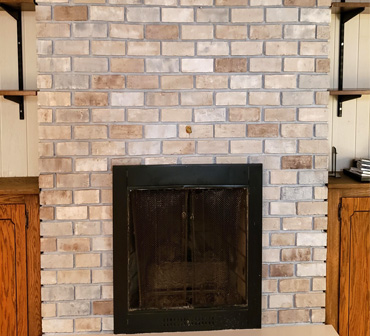 repainted fireplace brick in multi color neutral tones